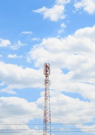 Industrial background. Aerial of cellular mobile phone, tv, internet and radio tower against the blue sky with copy space