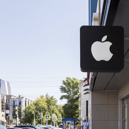 Saratov, Russia - 08242019: Sign on a store with the logo of the popular Apple company, outdoor advertising