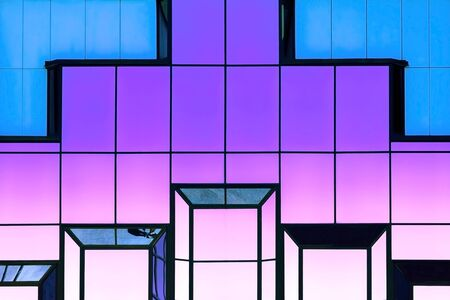 Abstract bright modern trendy neon magic geometric shining background with reflection glass texture of a glass mirror surface, blue magenta purple pink color with gradient 版權商用圖片