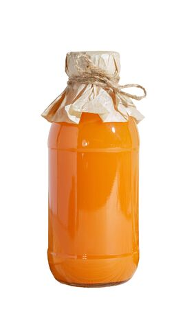 Vegetable fruit juice in a closed glass bottle of pumpkin orange carrot sea buckthorn bright orange color isolate on a white background. Home canning, healthy nutrition and diet for weight loss 写真素材