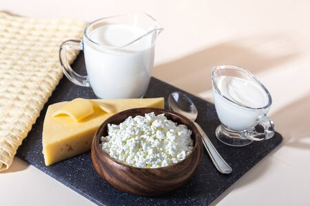 Food is a source of calcium, magnesium, protein, fats, carbohydrates, balanced diet. Dairy products on the table: cottage cheese, sour cream, milk, cheese, contain casein, albumin, globulin, free lactose