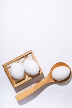 Chicken eggs, white black background with copy space. Food and products containing vitamins, proteins, amino acids, choline, lecithin, cholesterol, calcium, potassium, phosphorus, magnesium, iodine