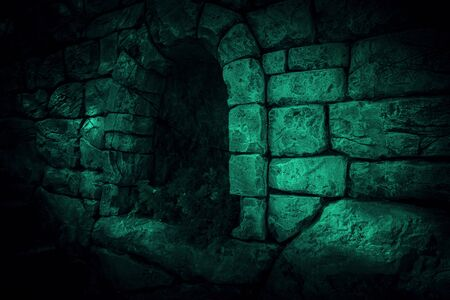 The corridor is horror, scary, darkness. Ghostly gloomy cave in the castle, alcove in the tunnel, entrance to the basement in the mystical night light of the moon with eerie strange shadows Stock Photo