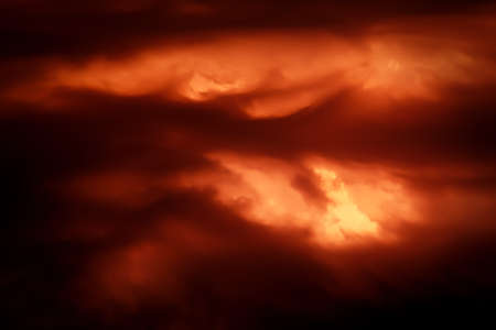 Fantastic concept mystical horror background from another planet from the paranormal world, fantasy style. Dramatic red black orange sky with scary hellish clouds and terrible shadows and fiery light Standard-Bild