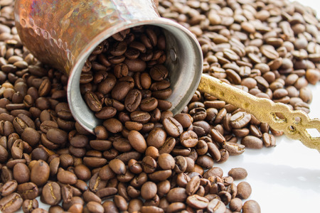 cezve: coffee beans scattered out Cezve Stock Photo