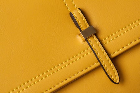 strap: Detail Leather yellow bags close-up, slider, strap, bag texture firmware.