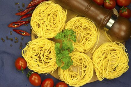 pepperbox: pasta and selection on dark blue  background