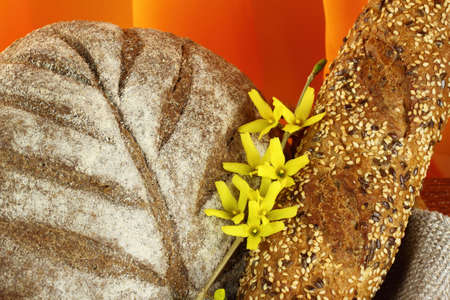 darck: Different types of darck  bread  close-up with   flower Stock Photo