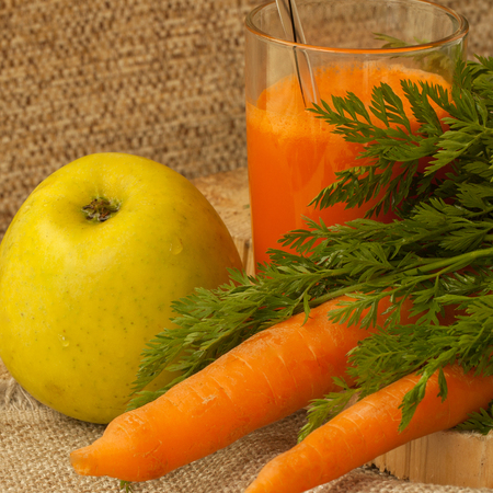 squeeze shape: Natural organic carrot and carrot fresh juice as source of vitamin A, carotene and other vitamins Stock Photo