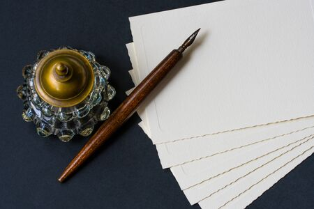 inkwell: Vintage background with old fountain pen, inkwell, papers