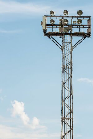 rigid: Large tall high outdoor stadium spotlights on rigid frame construction with blue sky background