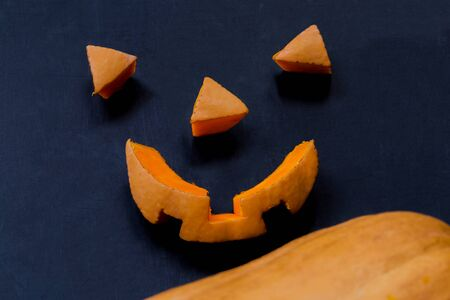 minutiae: Cut parts of a smiling scary halloween pumpkin close-up