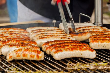 browned: Barbecue, spicy browned sausages on the hot grill .Grill concept