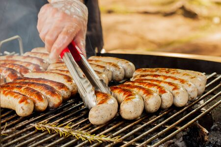 browned: Summer BBQ. Grill spicy browned sausage on the barbecue-party