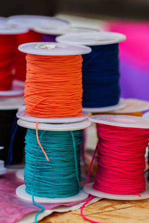 coils: Various color of bright ropes on coils for different applications, vertical view, selective focus