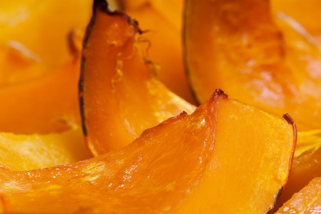 autumn colour: Vivid orange colour slices of baked pumpkin with a honey, hot dessert in autumn Stock Photo