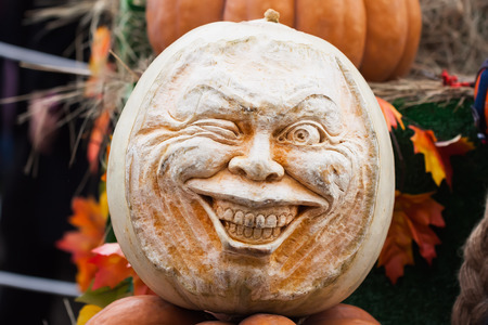 Skillfully carved head of pumpkins, decorations for the autumn holidays