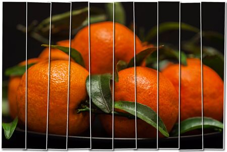 Creative collage from 1 frame. Ripe orange tangerines with green leaves in plate on black , top view. Low key. Healthy nutrition, diet, detox. Selective focus Stock Photo