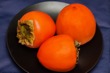 Persimmon fruit is a golden yellow flavorful delicacy from far East Asian origin.