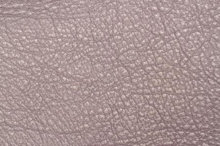 Ash pink, Hazelnut, trendy color leather texture background close-up Reklamní fotografie