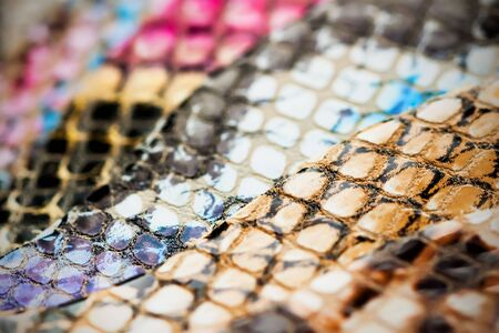 Genuine leather, color samples with Texture under the skin exotic reptile for fashion industry. Selective focus