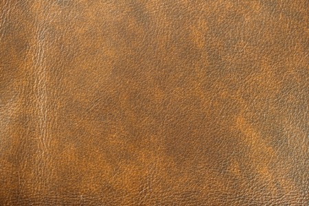 Texture of Genuine Leather spotted, painted, with wrinkle, crease, brown color, background, surface.