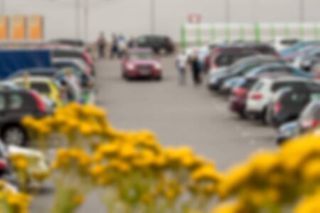 public insurance: Blur image of parking   next to modern shopping mall at peak hour. Blurred background abstract Stock Photo