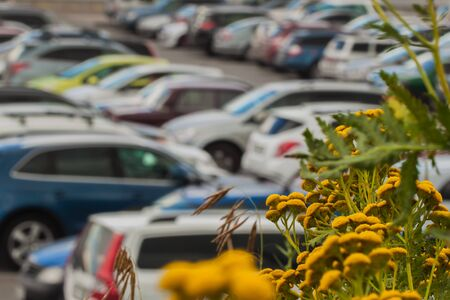 Blur of cars at public parking to modern mall, Blurred background abstract