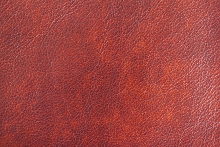 Texture of Genuine Leather shiny, antique, cracked, ,maroon color, background, surface.