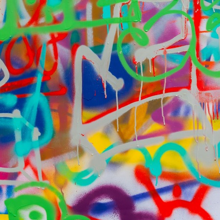 Beautiful street art graffiti closeup. Abstract creative drawing fashion colors on the wall of the city. Urban modern culture Stock Photo