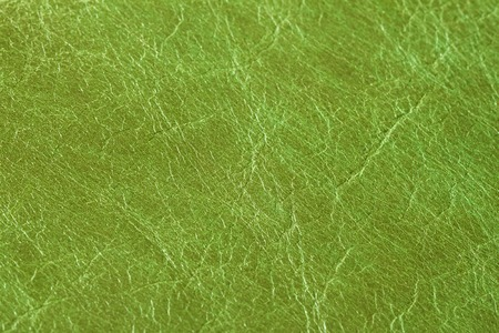 Texture of genuine leather close-up, fashion green color. For background , backdrop, substrate, composition use. With place for your text Stock Photo