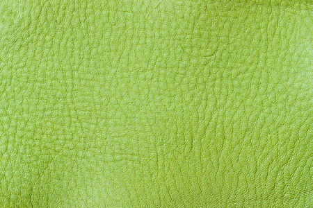 Texture of genuine leather close-up, fashion spring green color. For background , backdrop, substrate, composition use. With place for your text Stock Photo