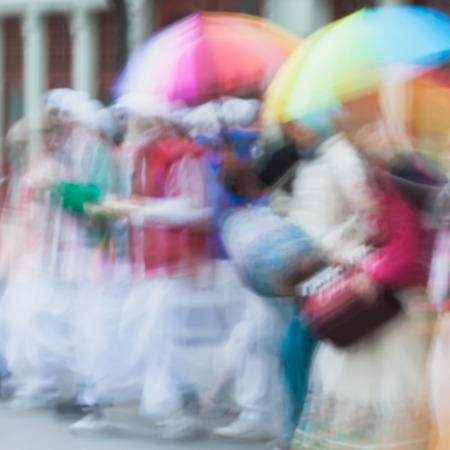 vedas: Abstract defocused motion blurred. People group of Hare Krishna, Believers of the Society for Krishna Consciousness sing Hindu mantra Hare Krishna
