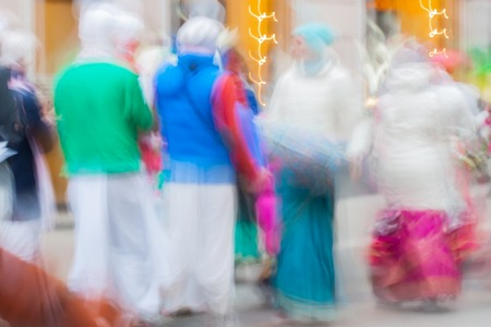 vedas: Abstract defocused motion blurred People group of Hare Krishna movement singing and dancing in the streets of the city with the words Hare Krishna