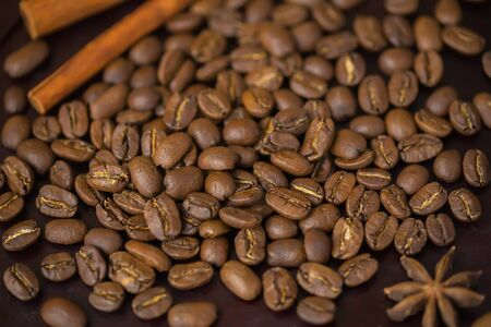 connoisseurs: Grains of coffee close-up. Texture of extra large arabica Maragogype bean of very high quality, considered one of the best beans in the world. Coffee break concept. Stock Photo