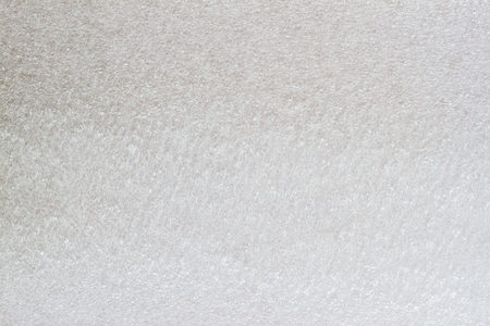 styrene: Texture of thermal insulating styrofoam close-up. Structure polystyrene plastic, light grey color. For background, design with copy space text or image