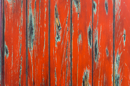 Vintage red shabby painted old wood planks with cracks and scratches for natural design, patterns, decoration