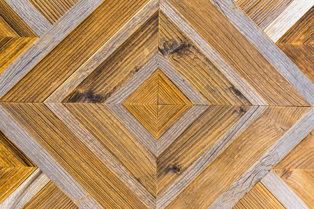 Close-up natural unpainted light wooden background with parquet wood pattern. For design, patterns, decoration
