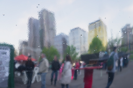 specular: Distorted reflection of city and people on metal surface, reminiscent of art, watercolor, impressionism. Concept of modern city, lifestyle. Abstract blurred background Stock Photo