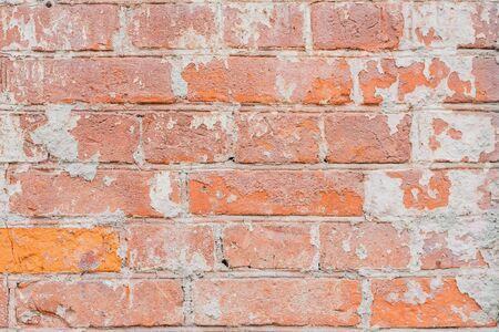 durable: Vintage damaged brick wall with cracks, background and texture, for natural design, patterns, extured background with space for copy text. Stock Photo