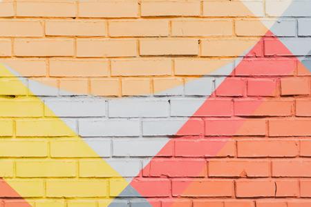 Graffity bakstenen muur, zeer klein detail. Abstract stedelijk het ontwerpclose-up van de straatkunst. Moderne iconische stedelijke cultuur, stijlvol patroon, modekleurenAerosol-afbeeldingen Stockfoto