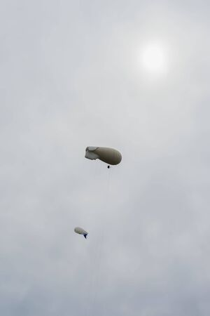 blimps: Two blimps, hot air airships on the background of the rainy sky. Inflatable dirigibles. Lots of place for writing text around it. For background Stock Photo