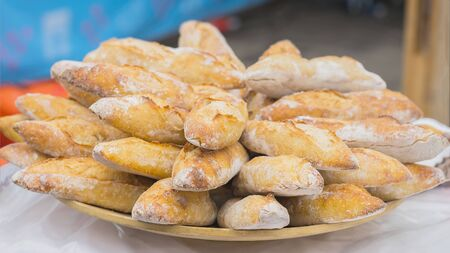 Close-up of fresh bread, hot organic baguettes for sandwiches in market, selective focus. Stock Photo