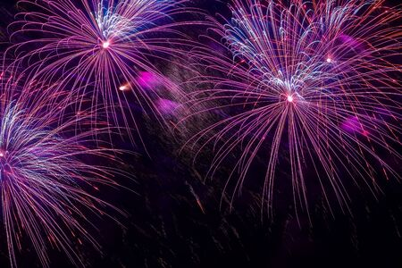 Close-up of vivid purple fireworks with sparks. Explosive pyrotechnic devices for aesthetic and entertainment purposes, art. Colored fireworks, holiday background