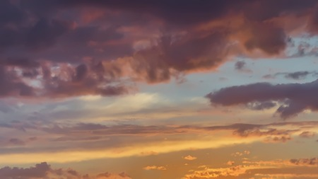 Soft blurred Scenic view of beautiful sunset, golde and purple clouds, evening sky. Natural background