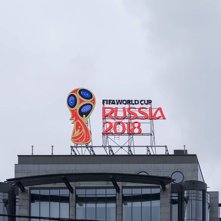 MOSCOW, RUSSIA - OCTOBER 28, 2017 Official emblem, logo of the 2018 World Cup on the roof of building on one of capitals street against the sky Editorial
