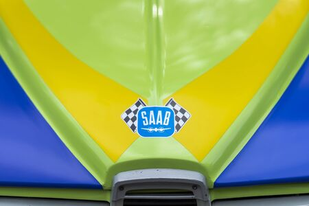 MOSCOW, RUSSIA - AUGUST 26, 2017: SAAB Scania car logo on bright multicolor vintage car close-up, selectiv focus. Retro cars festival