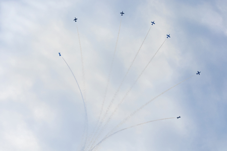 Airplanes on aerobatic show, bright aerobatics with smoke trails. Exciting performance. Air performance, aircrafts, flying display and skill teamwork 写真素材