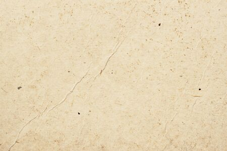 Texture of old organic light cream paper with wrinkles, background for design with copy space text or image. Recyclable material, has small inclusions of cellulose 스톡 콘텐츠