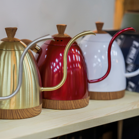 Modern metallic colorful teapots for filtered coffee, professional equipment at coffee shop